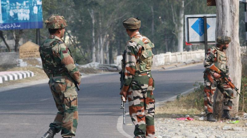 Security personnel take positions during a gun battle with suspected militants at Army camp at Nagrota near Jammu. (Photo: PTI)