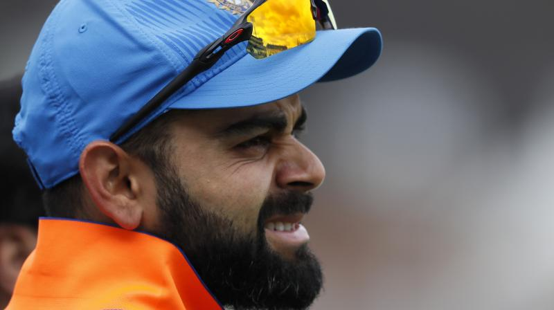 """""""Eventually, we were not good enough with the bat. When you are chasing 200, all the batsmen need to chip in, or one batsman has to keeping going at a 200 strike-rate,"""" said Indian skipper Virat Kohli after team's loss in the second Twenty20 against New Zealand in Rajkot. (Photo: AP)"""