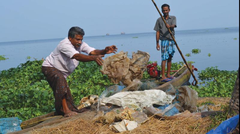 Fishermen collect plastic waste from lake 	— DC File