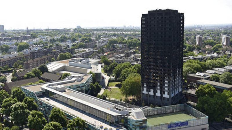 Police say London tower blaze began in Hotpoint fridge freezer; at least 79 killed