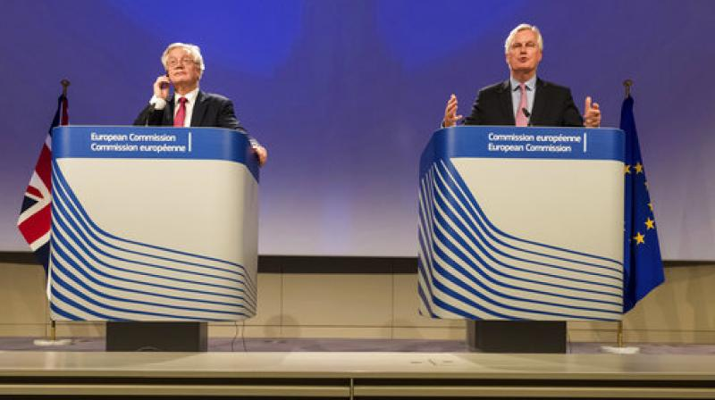 EU Chief Brexit Negotiator Michel Barnier, right, and British Secretary of State for Exiting the EU David Davis attend a media conference at EU headquarters in Brussels on Monday. (Photo: AP)
