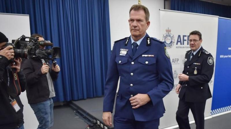 Australian Federal Police Deputy  Commissioner Michael Phelan and New South Wales Police Deputy Commissioner David Hudson leave a press conference after addressing the media in Sydney. (Photo: AFP)
