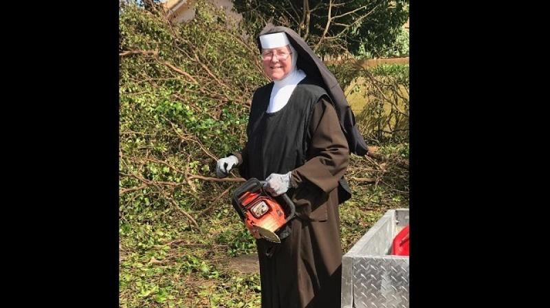 Nun with chainsaw takes on the mess Hurricane Irma left behind