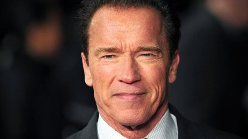 Arnold Schwarzenegger says he 'throws up' when looking in mirror
