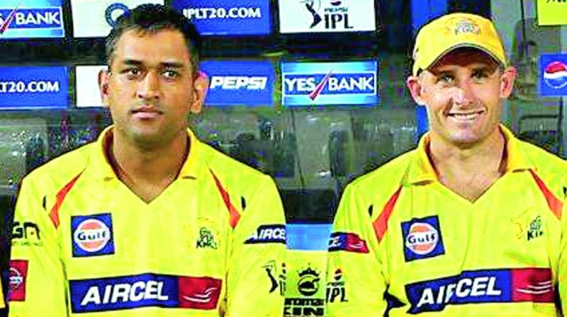 A file photo of M.S. Dhoni (left) and Michael Hussey.
