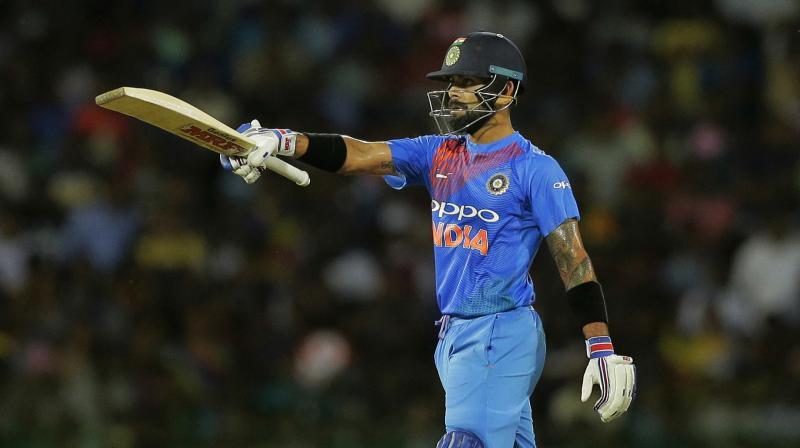 India's captain Virat Kohli raises his bat after scoring a half century during the Twenty20 cricket match against Sri Lanka in Colombo, Sri Lanka, Wednesday (Photo: AP)