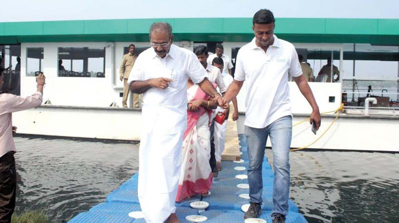 Transport minister A.K. Saseendran coming out of solar boat 'Aditya' after the successful completion of its first trial run in Aroor on Friday. (Photo: DC)
