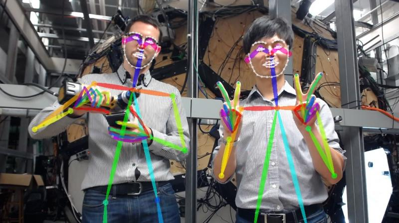 This real-time detector sees hand poses and tracks multiple people. (Image: Carnegie Mellon University)