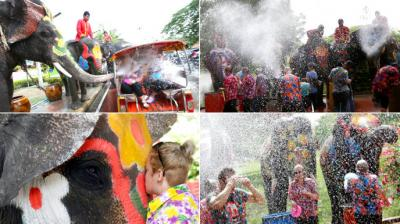 Locals in Thailand celebrate the Buddhist New Year of Songkran by entertaining tourists with water sprays from elephants. (Photo: AP)