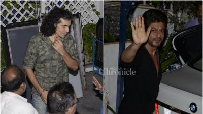 Late Thursday night, our shutterbug spotted Shah Rukh Khan stepping out of Bungalow 8 in Bandra with filmmaker Imtiaz Ali. (Photo: Viral Bhayani)
