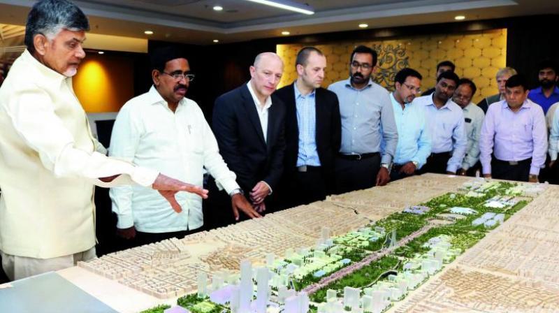 Chief Minister N. Chandrababu Naidu and Minister for Municipal Administration P. Narayana check Amaravati core capital city design at AP Secretariat, Velagapdui village. (Photo: DC)
