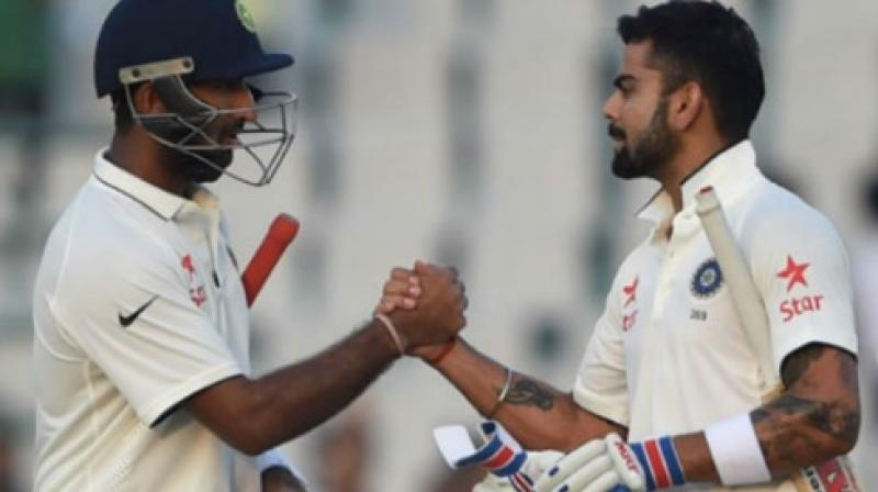 """You know what a valuable player he (Cheteshwar Pujara) is for us. He is the most composed player we have in the team,"" said Virat Kohli while praising Pujara. (Photo: AFP)"