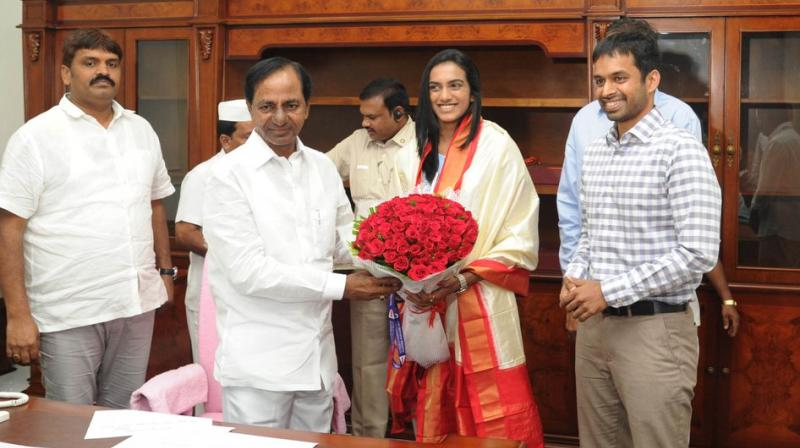 PV Sindhu, coach Gopichand call on Tel CM