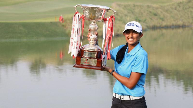 Aditi Ashok poses after receiving the Hero Women's Indian Open Golf trophy in Gurugram on Sunday (Photo: AP)