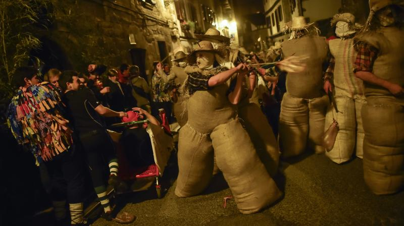 Carnival celebrations are in full swing in Spain, and revellers have donned their costumes and masks to mark the occasion. People dressed as the traditional carnival characters 'Zaku Zaharrak,' or old sack, in Basque language, as they take part in a carnival parade in the small Pyrenean village of Lesaka, northern Spain.