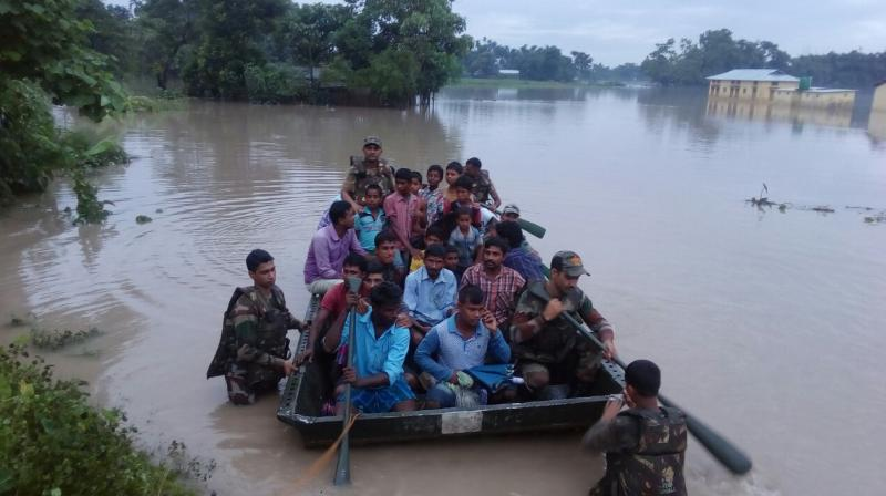 At least 14 people, including a minor were reported to have died due to second wave of floods, which has wreaked havoc in 19 out of 33 districts of the state. (Photo: DC/Manoj Anand)