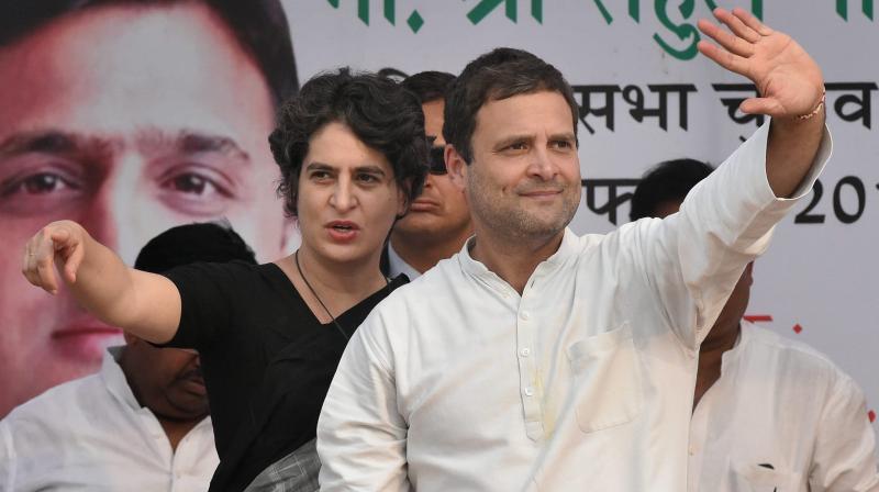 Congress Vice President Rahul Gandhi with sister Priyanka Gandhi Vadra at an election rally in Raebareli. (Photo: PTI)