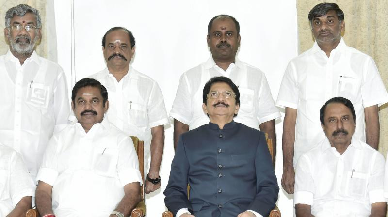 Chief Minister Edappadi K Palanisamy with Governor CH Vidyasagar Rao and his cabinet colleagues pose for a group photograph after swearing-in ceremony at Raj Bhavan in Chennai. (Photo: PTI)