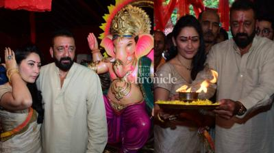 Sanjay and Maanayata Dutt got themselves involved in festive spirit by performing the aarti and participating in other customs in Mumbai on Wednesday on the occasion of the festival of Ganesh Chaturthi to be celebrated in the country from Friday. (Photo: Viral Bhayani)