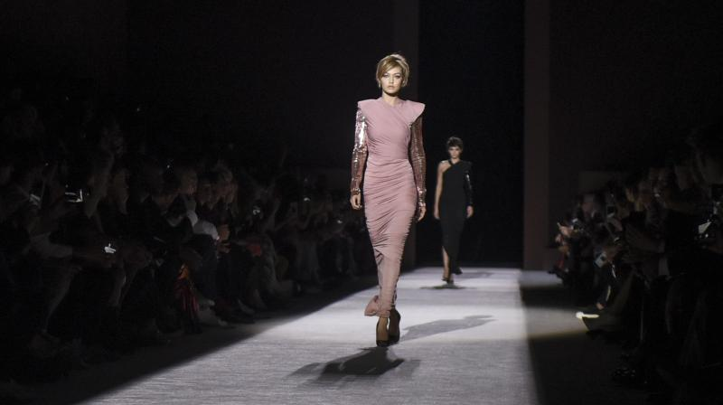 Designer transforms Park Avenue Armory as he showcases his glamorous, sharp, and sexy Spring 2018 collection. (Photo: AP)