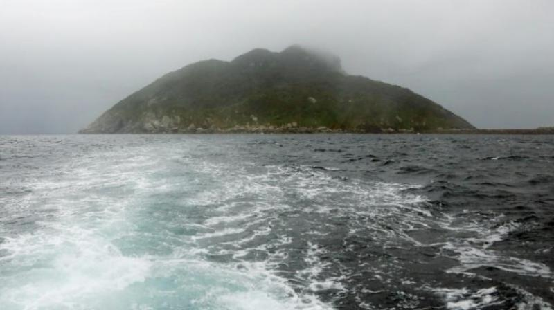 Island is permanently manned by a Shinto priest who prays to the island's goddess, in a tradition that has been kept up for centuries (Photo: AFP)