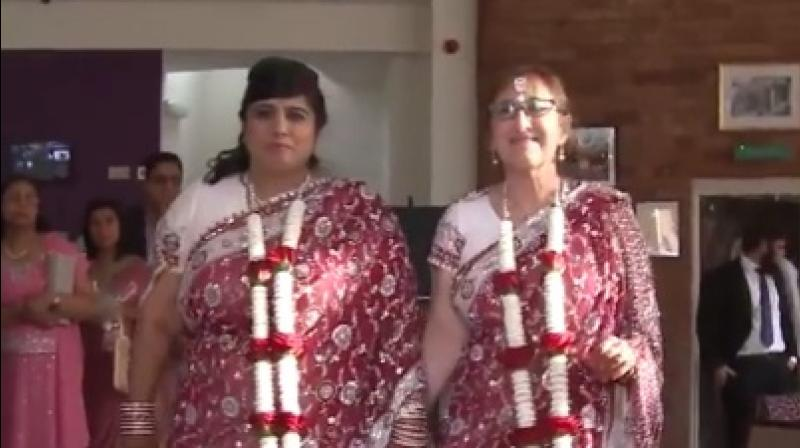 Britain's first interfaith lesbian wedding: Hindu-Jewish couple ties the knot