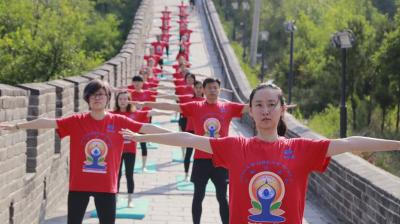 For the first time in China, a yoga program was held on the iconic Great Wall to celebrate the International Yoga Day on Wednesday. (Photo: PIB)