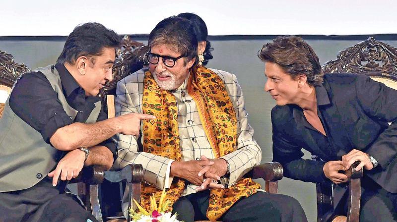 Film actors Amitabh Bachchan, Shah Rukh Khan and Kamal Hasan interact with each other during the inauguration of '23rd Kolkata International Film Festival', in Kolkata on Friday. (Photo: PTI)