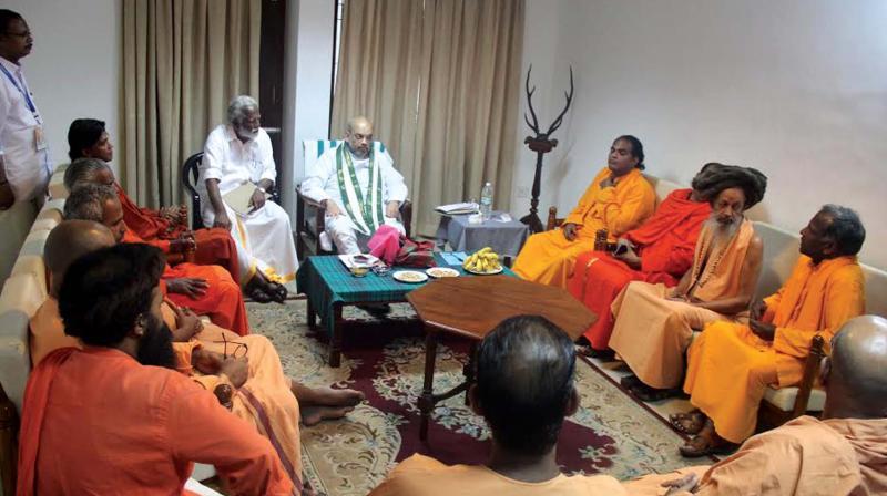BJP national president Amit Shah holds talks with sanyasis from various religious mutts in Thiruvananthapuram on Sunday. BJP state president Kummanam Rajasekharan is also seen.(Photo: DC)