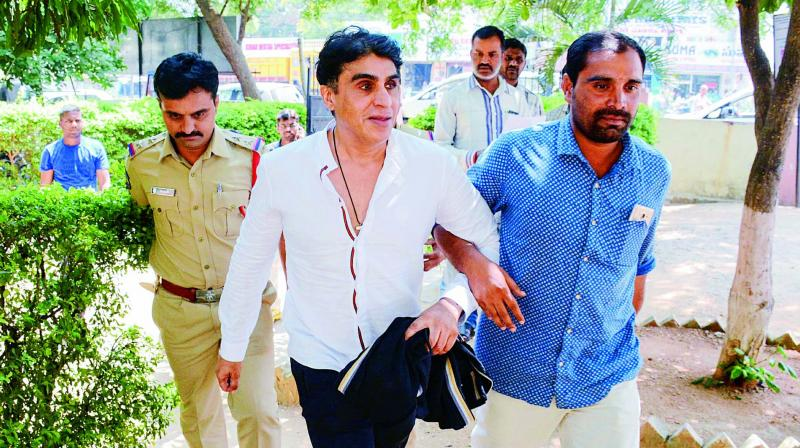 Film producer Karim Morani surrenders before Hyderabad police in rape case