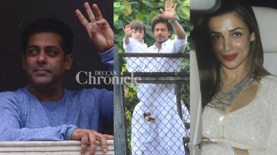 Superstars Salman Khan and Shah Rukh Khan spread joy on the occasion of Eid with their friends, family and media on Monday in Mumbai. (Photo: Viral Bhayani)