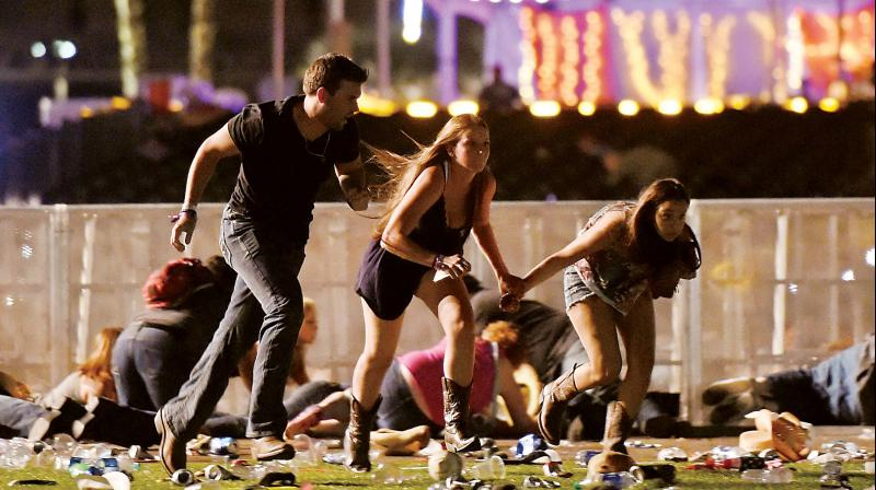 File photo of people fleeing from the open air Route 91 Harvest country music festival, Las Vegas, after a gunman opened indiscriminate fire at the audience. (Photo: AFP)