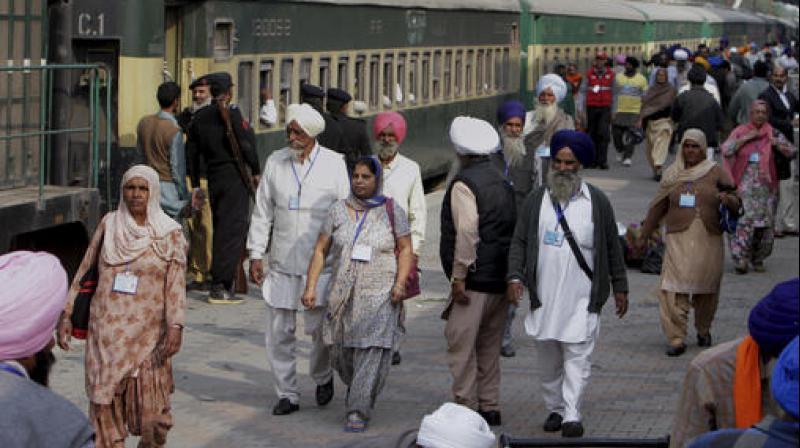 Guru Nanak Dev's 548th birthday: Sikh pilgrims arrive in Lahore