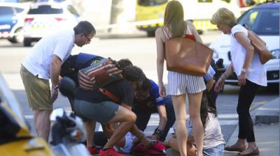 A van veered onto a promenade in central Barcelona on Thursday, killing 13 people and injuring 100. Spain authorities called it a terrorist attack and said 15 people were seriously injured.