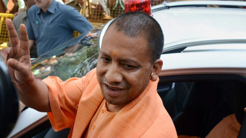 Uttar Pradesh Chief Minister Yogi Adityanath leaves after a meeting in Lucknow. (Photo: PTI)