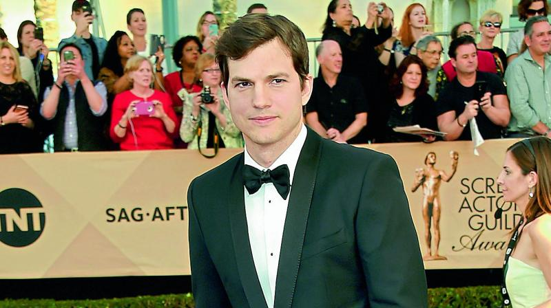 Ashton Kutcher on tabloid pictures: That's my cousin