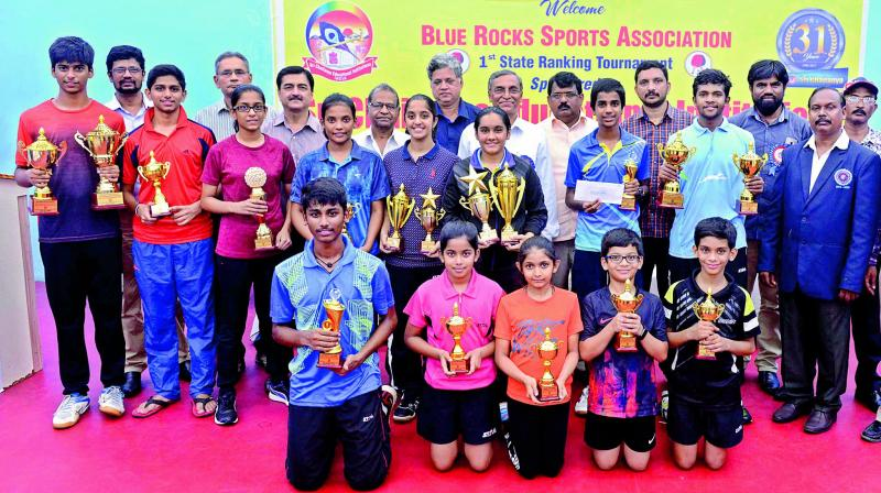 Winners and runners-up pose with their trophies at the Telangana State Ranking table tennis tournament played in Hyderabad.