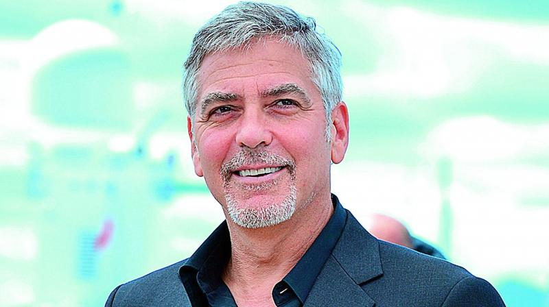 George Clooney vows to sue French magazine