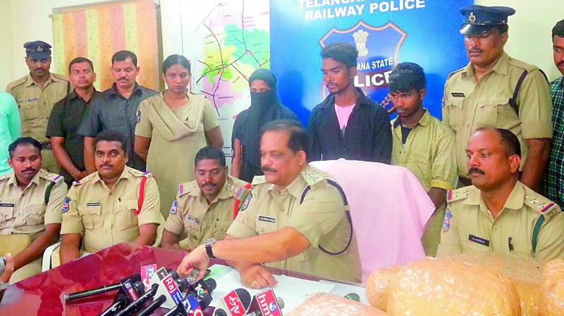 Railway police in-charge SP S. Rajendra Prasad speaking to the media after arresting the ganja smugglers  (Photo: DC)