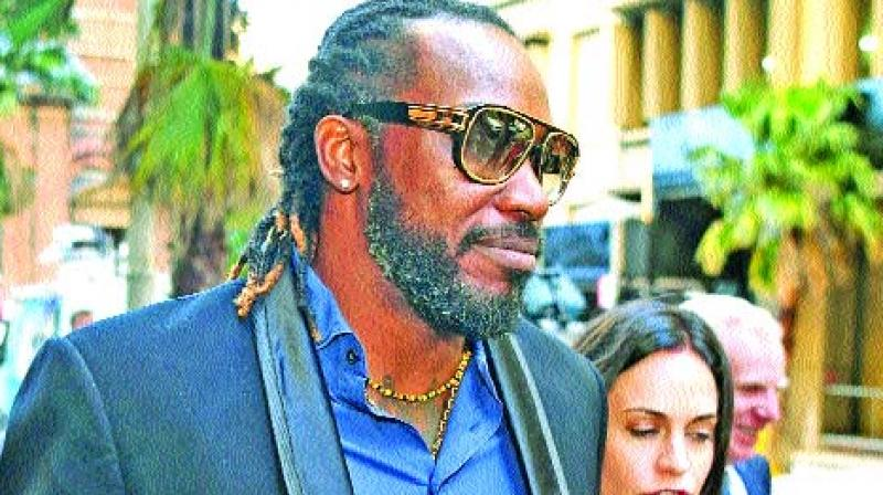 Chris Gayle leaves the NSW Supreme Court after the opening day of his defamation action. (Photo: AFP)