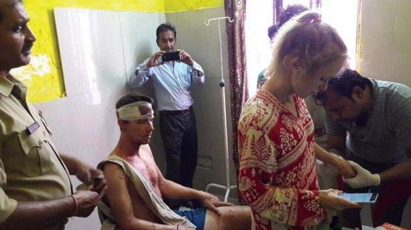 The couple from Lausanne in Switzerland was chased and attacked on Sunday with stones and sticks by a group of youth in the tourist town of Fatehpur Sikri, about 40 km from Agra. (Photo: Twitter | @ANINewsUP)