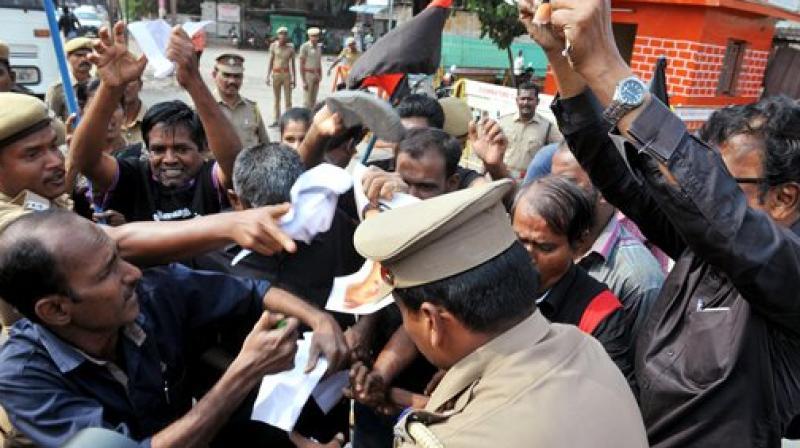 Members of Thandhai Periyar Dravida Kalagham raising slogans during a protest against BJP leader Subramanian Swamy in Coimbatore. (Photo: AP)