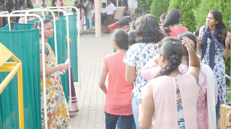 Female candidates undergoing security check at an NEET centre in Bengaluru on Sunday  -DC
