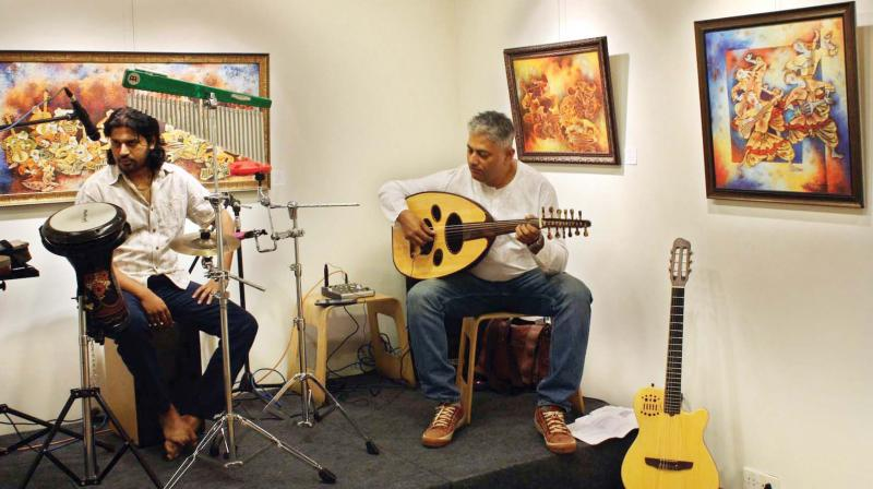 (Right) Jagadeesh M.R., director, Bangalore School of Music, plays the oud at a local art gallery.