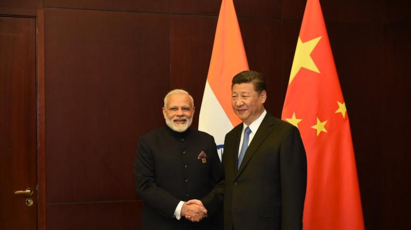 Modi meets Xi amidst differences over NSG bid, CPEC