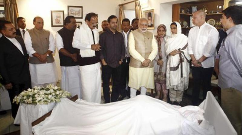 Prime Minister Narendra Modi with M Venkaiah Naidu, Rajnath Singh and other dignitaries while paying their last respects to IUML MP from Kerala E Ahamed at his residence in New Delhi on Wednesday. (Photo: PTI)