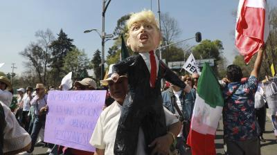 About 20,000 people staged a march through Mexico's capital demanding respect for their country and its migrants in the face of perceived hostility from the administration of US President Donald Trump.