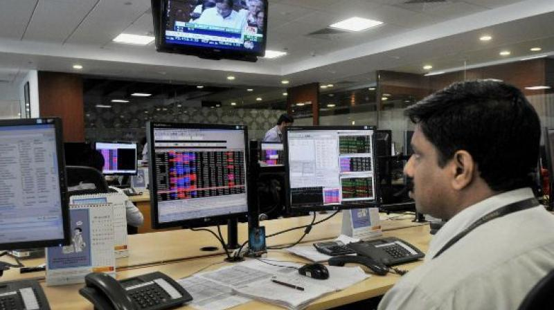 Sensex trips 97 points, Nifty below 9100 on global weakness