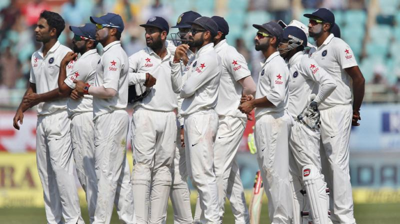 England collapse gives India big win and series lead