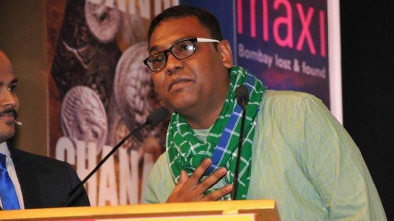 Dr Hansda Sowvendra Shekhar said a story in his book ' The Adivasi will not dance' talks about how hunger pushes a girl to desperation. (Photo: Facebook)
